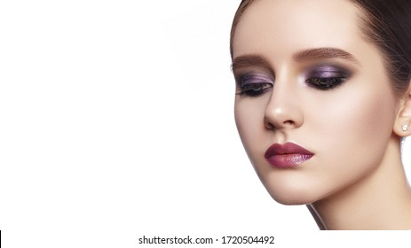 Beautiful Woman with Professional Makeup. Celebrate Style Eye Make-up, Perfect Eyebrows, Shine Skin. Bright Fashion Look. Evening visage with smooth skin and shimmer foundation