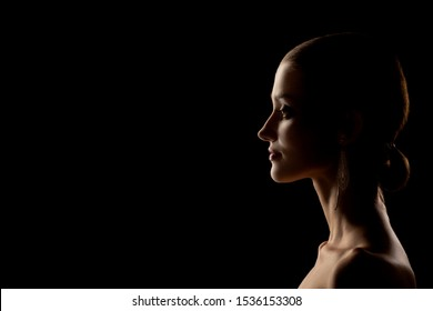 beautiful woman profile silhouette on black background with copy space