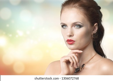 Beautiful woman in profile touching her lips. Photo of woman finishes makeup on beige background. Youth and skin care concept          - Image