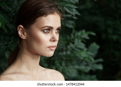 beautiful woman in profile in tropics leaves nature summer