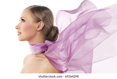 Beautiful woman in purple color scarf on white