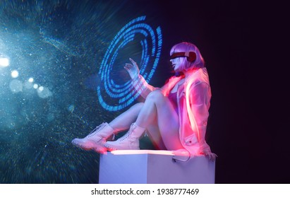 Beautiful woman with purple hair in futuristic costume on dark background. Girl in glasses of virtual reality. Augmented reality game, future technology, AI concept. Holographic interface.