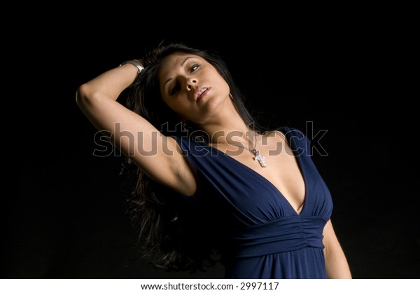 Beautiful woman pushing hair out of here face