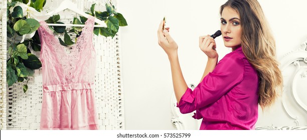 Beautiful woman putting on makeup in the morning letterbox