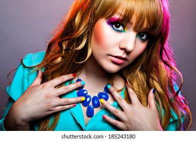 Beautiful woman with rainbow eye make-up