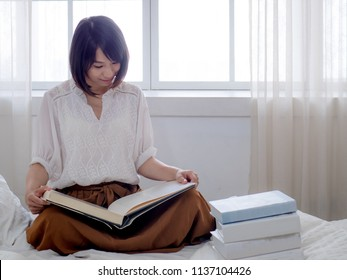 beautiful woman reading a book in morning