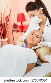 a beautiful woman receiving a facial treatment