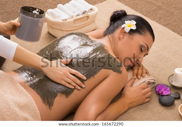 Beautiful Woman Receiving A Mud Therapy