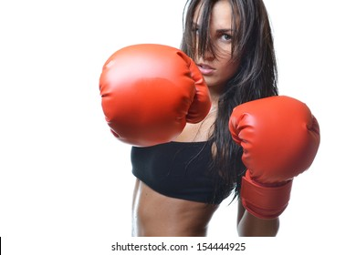 beautiful woman with the red boxing gloves, isolated on white background