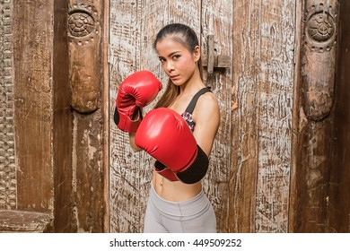 Beautiful woman with the red boxing gloves.