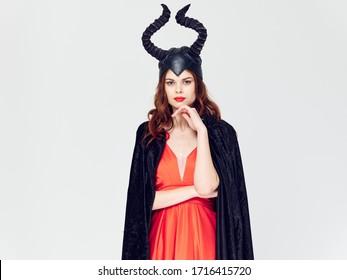 Beautiful woman in red dress black cape maleficent film Fan horns