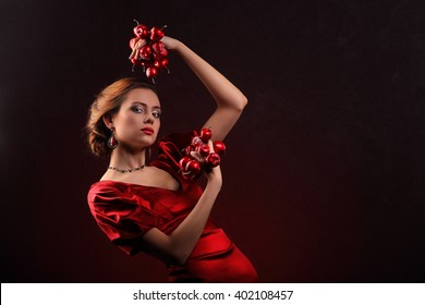 Beautiful woman in red dress with professional make up studio
