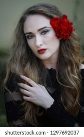 beautiful woman with red flowers in her hair