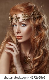 Beautiful woman , red hair , professional make-up , gold color, golden jewelery , beauty pure skin model close-up portrait .