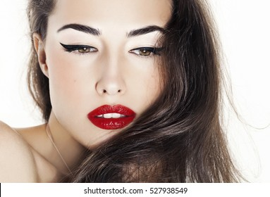 beautiful woman with red lips and black eyeliner, closeup portrait