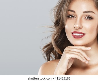 Beautiful woman red lips fly hair portrait healthy skin