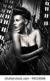 beautiful woman with red lips in rainy city