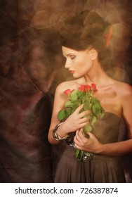Beautiful Woman With Red Roses.