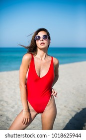 Beautiful woman in red swimsuit