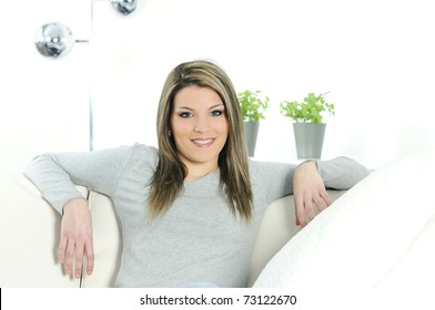 beautiful woman relaxed at home in a sofa