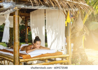Beautiful woman is relaxing after traditional Thai massage