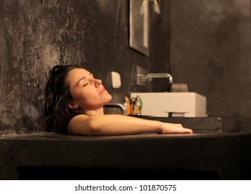 Beautiful woman relaxing in a bathtub