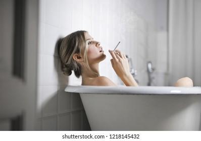 Beautiful woman relaxing in a bathtub.