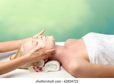 Beautiful woman relaxing during a massage