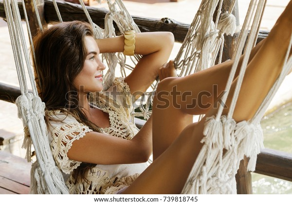 Beautiful woman relaxing in the hammock