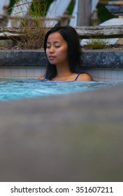 Beautiful woman relaxing in a hot tub