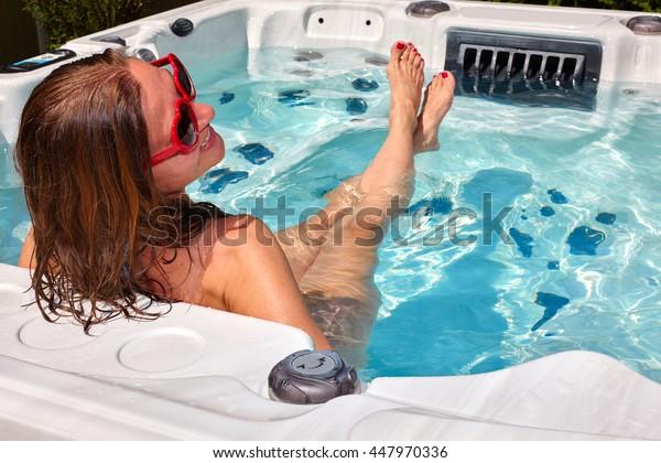 Beautiful woman relaxing in hot tub.