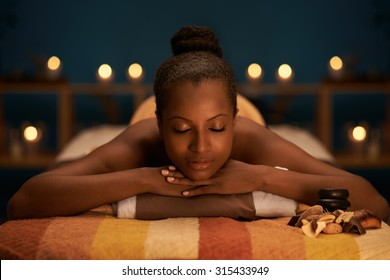 Beautiful woman relaxing in luxury spa salon