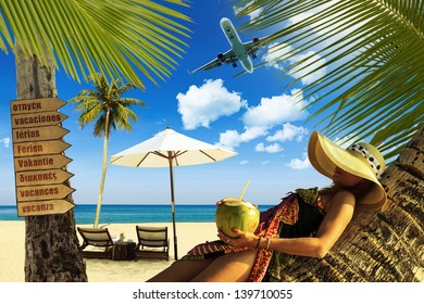 Beautiful woman relaxing on a coconut tree on the beach in Thailand TRAVEL CONCEPT