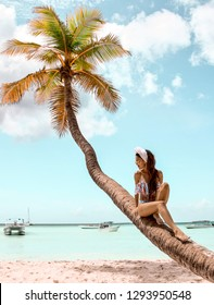 Beautiful woman relaxing on tropical beach. Sunny vacation day in paradise.