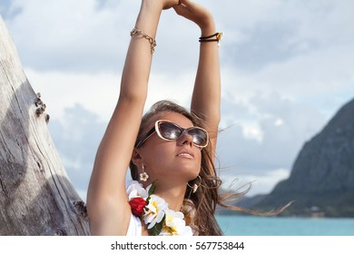 Beautiful woman relaxing. Travel, beach and vacation holidays concept. Hawaiian Island Oahu