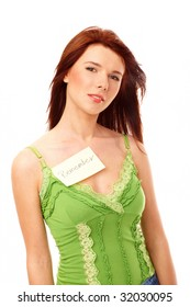 Beautiful woman with remember sticky note attached to her shirt