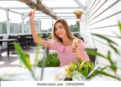 Beautiful woman restaurant dress, girl summer cafe. Waving hand, giving lead friends, greets guests, asks bill lunch dinner breakfast. Long hair everyday makeup. Happy smiling resting after work.