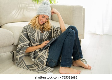 beautiful woman resting at home and surfing on social media