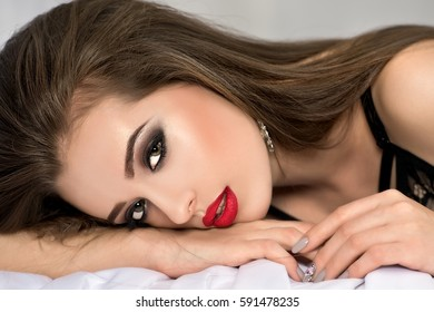 Beautiful woman resting on the bed. Young woman with perfect body posing in lingerie. Series