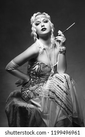 beautiful woman retro flapper style smoking outdoors
