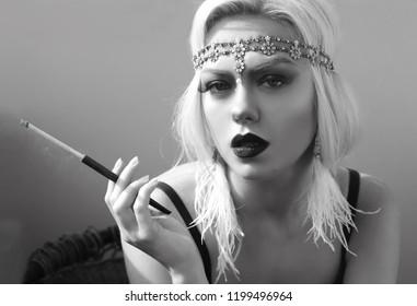 beautiful woman retro flapper style smoking outdoors