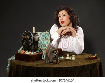 beautiful woman retro style sitting at table alone dreaming