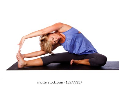 Beautiful woman Revolved Head to Knee Forward Bend Parivrtta Janu Sirsasana in yoga stretching, on white.