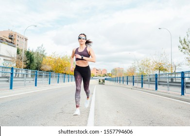 Beautiful woman running in the city. Fitness, workout, sport, lifestyle concept