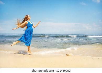beautiful woman running on beach bali