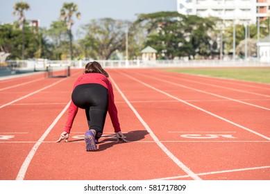 Beautiful woman running in the stadium.