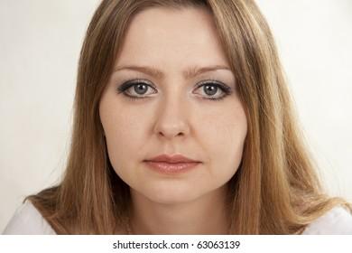 Beautiful woman sad. White background