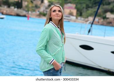 Beautiful woman sailing, young adult lady enjoying summer travel. European girl tourist traveling around the world