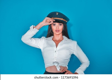 beautiful woman saluting dressed for acting.