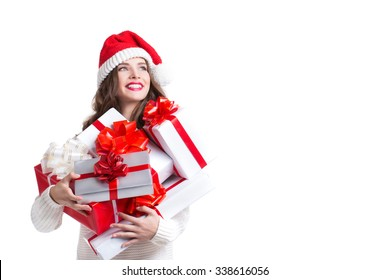 Beautiful woman in santa hat and gifts.